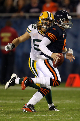 CHICAGO - SEPTEMBER 27:  Jay Cutler #6 of the Chicago Bears scrables with the ball as he is pressured by Clay Matthews #52 of the Green Bay Packers at Soldier Field on September 27, 2010 in Chicago, Illinois. Matthews was called for a facemask on the play