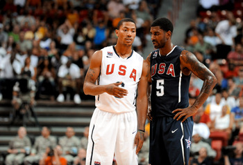 LAS VEGAS - JULY 24:  Derrick Rose #6 and O.J. Mayo #5 of the 2010 USA Basketball Men's National Team talk on the court during a break in the action at a USA Basketball showcase at the Thomas & Mack Center July 24, 2010 in Las Vegas, Nevada.  (Photo by Et