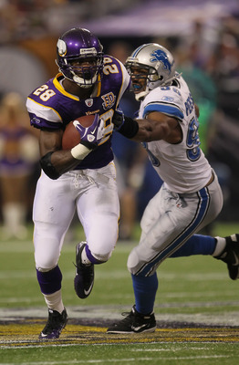 MINNEAPOLIS - SEPTEMBER 26:  Running back Adrian Peterson #28 of the Minnesota Vikings carries the ball while being pursued by Julian Peterson #98 of the Detroit Lions during the second half at Hubert H. Humphrey Metrodome on September 26, 2010 in Minneap