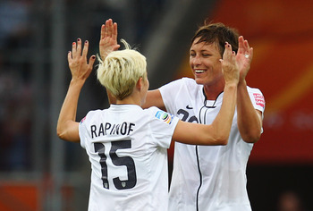 SINSHEIM, GERMANY - JULY 02: Megan Rapinoe (L) and Abby Wambach of USA celebrate after the FIFA Women's World Cup 2011 Group C match between USA and Colombia at the Fifa Womens World Cup Stadium on July 2, 2011 in Sinsheim, Germany.  (Photo by Alex Grimm/