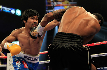 LAS VEGAS, NV - MAY 07:  (L-R) Manny Pacquiao of the Philippines throws a left at Shane Mosley in the WBO welterweight title fight at MGM Grand Garden Arena on May 7, 2011 in Las Vegas, Nevada.  (Photo by Chris Trotman/Getty Images)