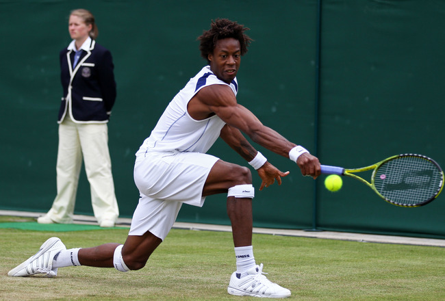 LONDON, ENGLAND - JUNE 24:  Gael Monfils of France in action during his third round match against  Lukasz Kubot of Poland on Day Five of the Wimbledon Lawn Tennis Championships at the All England Lawn Tennis and Croquet Club on June 24, 2011 in London, En
