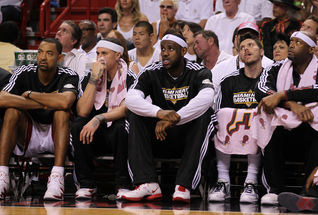 MIAMI, FL - JUNE 12:  (L-R) Juwan Howard #5, Mike Bibby #0, LeBron James #6, Mike Miller #13 and Erick Dampier #25 of the Miami Heat look on from the bench in the first half against the Dallas Mavericks in Game Six of the 2011 NBA Finals at American Airli