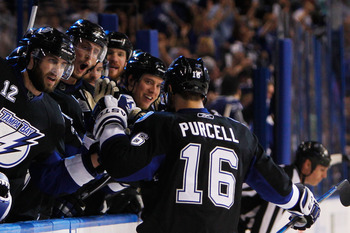 TAMPA, FL - MAY 25:  Teddy Purcell #16 of the Tampa Bay Lightning celebrates his second period goal with teammates in Game Six of the Eastern Conference Finals against the Boston Bruins during the 2011 NHL Stanley Cup Playoffs at St Pete Times Forum on Ma
