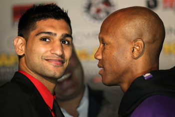 LOS ANGELES, CA - JUNE 08:  Amir Khan (L) and Zab Judah face off at a press conference to discuss their upcoming Super Lightweight World Championship Unification Fight at ESPN Zone At L.A. Live on June 8, 2011 in Los Angeles, California.  (Photo by Stephe