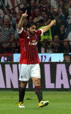 MILAN, ITALY - MAY 14:  Gennaro Gattuso of Milan celebrates after scoring  second teams  goal during the Serie A match between AC Milan and Cagliari Calcio at Stadio Giuseppe Meazza on May 14, 2011 in Milan, Italy.  (Photo by Dino Panato/Getty Images)