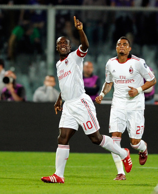 FLORENCE, ITALY - APRIL 10:  Clarence Seedorf of AC Milan celebrates scoring the first goal during the Serie A match between ACF Fiorentina and AC Milan at Stadio Artemio Franchi on April 10, 2011 in Florence, Italy.  (Photo by Claudio Villa/Getty Images)