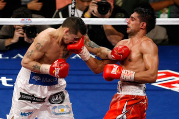 LAS VEGAS - DECEMBER 11:  (R-L) Amir Khan of England connects with a right to the face of Marcos Maidana of Argentina during the WBA super lightweight title fight at Mandalay Bay Events Center on December 11, 2010 in Las Vegas, Nevada.  (Photo by Ethan Mi