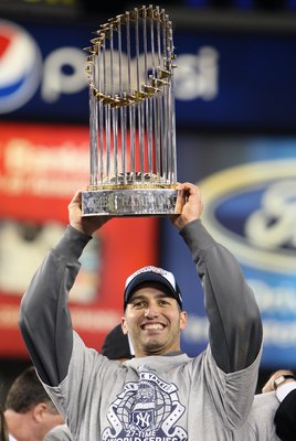 NEW YORK - NOVEMBER 04:  Andy Pettitte #46 of the New York Yankees celebrates with the trophy after their 7-3 win against the Philadelphia Phillies in Game Six of the 2009 MLB World Series at Yankee Stadium on November 4, 2009 in the Bronx borough of New