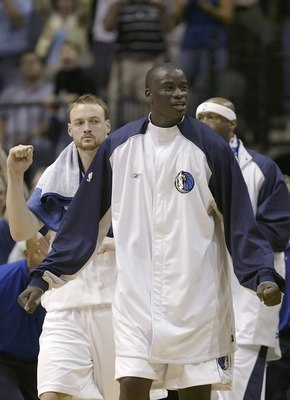 DALLAS - JUNE 01:  Keith Van Horn #2 (L) and DeSagana Diop #7 of the Dallas Mavericks celebrate in the final moments of the Mavericks win over the Phoenix Suns in game five of the Western Conference Finals during the 2006 NBA Playoffs on June 1, 2006 at A