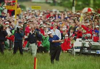 French golfer Jean Van de Velde narrowly misses winning the British Open Championship at Carnoustie, 18th July 1999. Here he plays his third short on the 18th hole from the deep rough near the grandstands. (Photo by David Cannon/Getty Images)