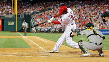 PHILADELPHIA - JUNE 24:  Domonic Brown #9 of the Philadelphia Phillies gets a one-out single to right against the Oakland Athletics in the bottom of the ninth at Citizens Bank Park on June 24, 2011 in Philadelphia, Pennsylvania.  The Phillies defeated the