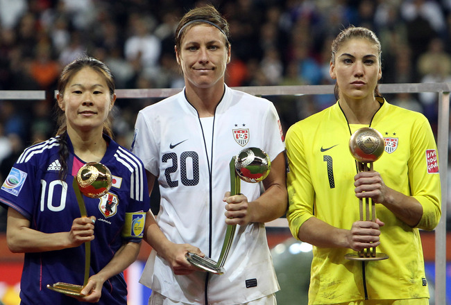FRANKFURT AM MAIN, GERMANY - JULY 17:  Homare Sawa of Japan , Abby Wambach and Hope Solo of USA pose for a photo after the FIFA Women's World Cup Final match between Japan and USA at the FIFA World Cup stadium Frankfurt on July 17, 2011 in Frankfurt am Ma