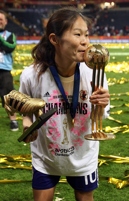 FRANKFURT AM MAIN, GERMANY - JULY 17:  Homare Sawa of Japan kisses the trophy after weinning 5-3 after penalty shoot-out the FIFA Women's World Cup Final match between Japan and USA at the FIFA World Cup stadium Frankfurt on July 17, 2011 in Frankfurt am