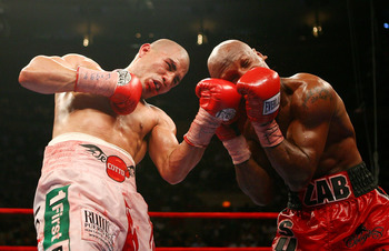 NEW YORK - JUNE 09:  Miguel Cotto of Puerto Rico lands a left uppercut on Zab Judah during their WBA Welterweight Championship bout on June 9, 2007 at Madison Square Garden in New York City.  (Photo by Nick Laham/Getty Images)