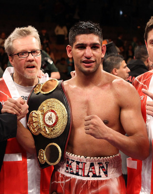 LAS VEGAS - DECEMBER 11:  Amir Khan of England celebrates after his unanimous decision victory with trainer Freddie Roach after defeating Marcos Maidana of Argentina in their WBA super lightweight title fight at Mandalay Bay Events Center on December 11,