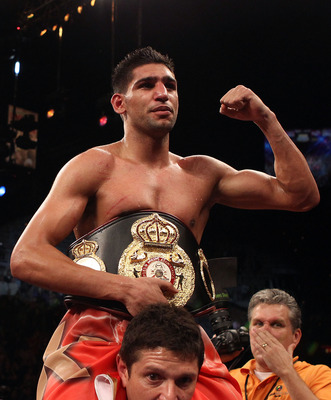 LAS VEGAS - DECEMBER 11:  Amir Khan of England celebrates after his unanimous decision victory against Marcos Maidana of Argentina after their WBA super lightweight title fight at Mandalay Bay Events Center on December 11, 2010 in Las Vegas, Nevada.  (Pho