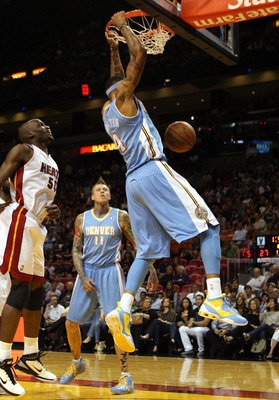 MIAMI, FL - MARCH 19:  Forward Kenyon Martin #4 of the Denver Nuggets dunks against the Miami Heat at American Airlines Arena on March 19, 2011 in Miami, Florida.  The Heat defeated the Nuggets 103-98. NOTE TO USER: User expressly acknowledges and agrees