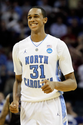 CHARLOTTE, NC - MARCH 20:  John Henson #31 of the North Carolina Tar Heels reacts after blocking the inbounds pass late in the second half before the Tar Heels defeated the Washington Huskies 86-83 during the third round of the 2011 NCAA men's basketball