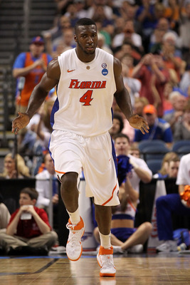 TAMPA, FL - MARCH 19:  Patric Young #4 of the Florida Gators reacts against the UCLA Bruins during the third round of the 2011 NCAA men's basketball tournament at St. Pete Times Forum on March 19, 2011 in Tampa, Florida.  (Photo by Mike Ehrmann/Getty Imag