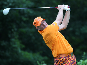 CROMWELL, CT  - JUNE 24:  John Daly hits a tee shot during the second round of the Travelers Championship at  TPC River Highlands on June 24, 2011 in Cromwell, Connecticut.  (Photo by Jim Rogash/Getty Images)