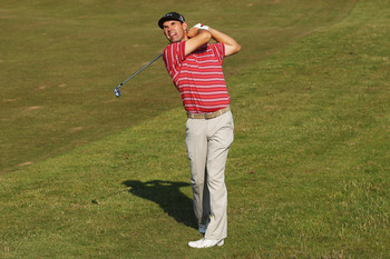 SANDWICH, ENGLAND - JULY 15:  Padraig Harrington of Ireland hits his 2nd shot on the 1st hole during the second round of The 140th Open Championship at Royal St George's on July 15, 2011 in Sandwich, England.  (Photo by Andrew Redington/Getty Images)