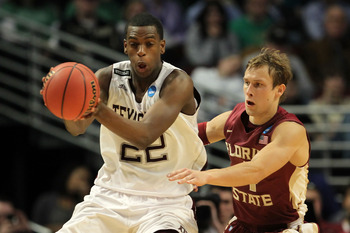 CHICAGO, IL - MARCH 18: Khris Middleton #22 of the Texas A&M Aggies controls the ball against Deividas Dulkys #4 of the Florida State Seminoles in the first half during the second round of the 2011 NCAA men's basketball tournament at the United Center on
