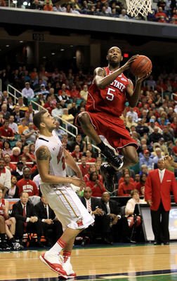 GREENSBORO, NC - MARCH 10:  C.J. Leslie #5 of the North Carolina State Wolfpack shoots against Jordan Williams #20 of the Maryland Terrapins  during the second half of the game in the first round of the 2011 ACC men's basketball tournament at the Greensbo