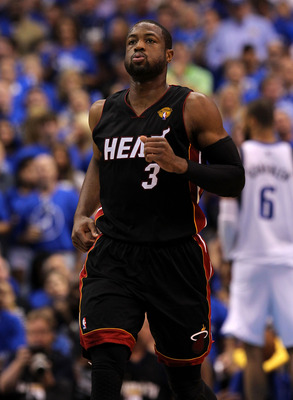 DALLAS, TX - JUNE 09:  Dwyane Wade #3 of the Miami Heat looks on during Game Five of the 2011 NBA Finals at American Airlines Center on June 9, 2011 in Dallas, Texas.  NOTE TO USER: User expressly acknowledges and agrees that, by downloading and/or using