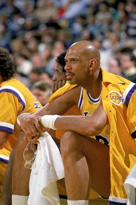1989: Kareem Abdul-Jabbar of the Los Angeles Lakers watches from the sidelines.  Mandatory Credit: Allen Dean Steele  /Allsport