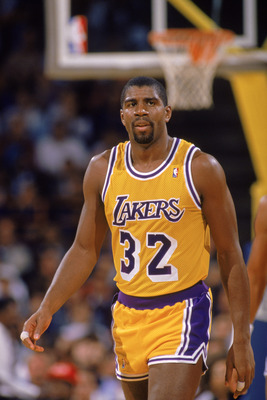 LOS ANGELES - 1988:  Magic Johnson #32 of the Los Angeles Lakers walks down the court during an NBA game at the Great Western Forum in Los Angeles, California in 1988.  (Photo by: Tim Defrisco/Getty Images)