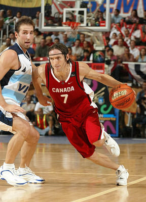 SAN JUAN, PUERTO RICO - AUGUST 30:  ***PUERTO RICO OUT, INTERNET OUT ***  Steve Nash #7 of Canada drives past Juan Sanchez #4 of Argentina during the semifinal Olympic qualifying game between Canada and Argentina on August 30, 2003 at Roberto Clemente Col