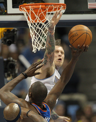DENVER, CO - APRIL 23:  Chris Andersen #11 of the Denver Nuggets fouls Nazr Mohammed #8 of the Oklahoma City Thunder in Game Three of the Western Conference Quarterfinals in the 2011 NBA Playoffs at Pepsi Center on April 23, 2011 in Denver, Colorado. NOTE