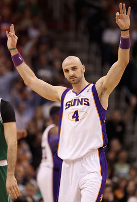 PHOENIX, AZ - JANUARY 28:  Marcin Gortat #4 of the Phoenix Suns reacts after hitting a three point shot at the end of the first quarter against the Boston Celtics during the NBA game at US Airways Center on January 28, 2011 in Phoenix, Arizona. The Suns d