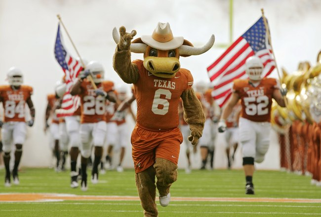 AUSTIN, TX - NOVEMBER 07:  The Texas Longhorns run on to the field for a game against the UCF Knights on November 7, 2009 at Darrell K Royal - Texas Memorial Stadium in Austin, Texas.  Texas won 35-3.  (Photo by Brian Bahr/Getty Images)