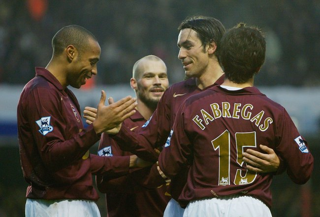 LONDON - JANUARY 14:  Robert Pires of Arsenal is congratulated by team mates after scoring the fourth goal of the game during the Barclays Premiership match between Arsenal and Middlesbrough at Highbury on January 14, 2006 in London, England.  (Photo by R