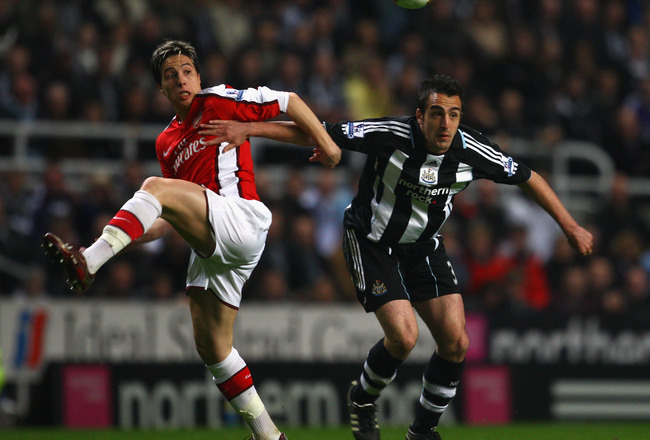 NEWCASTLE, UNITED KINGDOM - MARCH 21:  Jose Enrique of Newcastle United competes for the ball with Samir Nasri of Arsenal during the Barclays Premier League match between Newcastle United and Arsenal at St James' Park on March 21, 2009 in Newcastle, Engla
