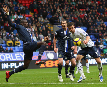BOLTON, ENGLAND - NOVEMBER 22:   Gary Cahill of Bolton Wanderers tangles with Christopher Samba of Blackburn Rovers during the Barclays Premier League match between Bolton Wanderers and Blackburn Rovers at the at Reebok Stadium on November 22, 2009 in Bol