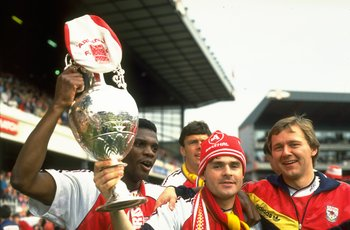 4 May 1991:  Paul Davis (left), Anders Limpar (centre) and Lewin (right) of Arsenal hold aloft the League Championship Trophy after winning a Division One match against Coventry at Highbury in London. Arsenal won the match 6-1.   \ Mandatory Credit: BenRa