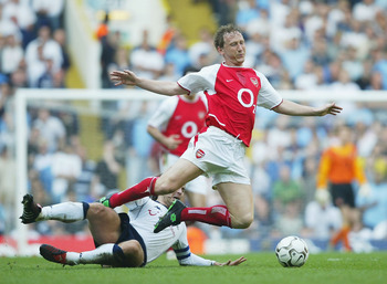 LONDON - APRIL 25:  Ray Parlour of Arsenal is challenged by Jamie Redknapp of Tottenham during the FA Barclaycard Premiership match between Tottenham Hotspur and Arsenal at White Hart Lane on April 25, 2004 in London.  (Photo by Shaun Botterill/Getty Imag