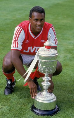 Jul 1987:  Portrait of David Rocastle of Arsenal posing with the Littlewoods Cup which Arsenal had won the season before during a photo-shoot held at Highbury, in London. \ Mandatory Credit: Russell Cheyne /Allsport