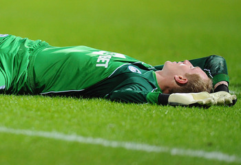 BOLTON, ENGLAND - JANUARY 05:  Chris Kirkland of Wigan Athletic is injured in a chellenge and stretchered off during the Barclays Premier League match between Bolton Wanderers and Wigan Athletic at Reebok Stadium on January 5, 2011 in Bolton, England.  (P