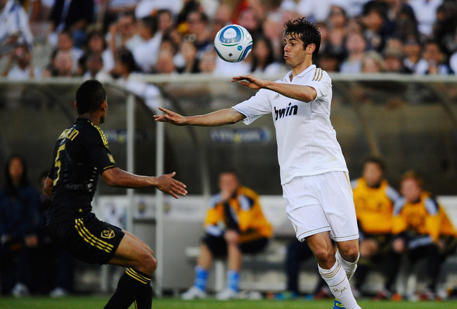 LOS ANGELES, CA - JULY 16:  Kaka #7 of Real Madrid controls the ball against Sean Franklin #5 of Los Angeles Galaxy during the Herbalife World Challenge 2011 friendly soccer game at Los Angeles Memorial Coliseum on July 16, 2011 in Los Angeles, California