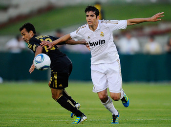 LOS ANGELES, CA - JULY 16: Kaka #7 of Real Madrid pushes Juninho #19 of Los Angeles Galaxy during the Herbalife World Challenge 2011 friendly soccer game at Los Angeles Memorial Coliseum on July 16, 2011 in Los Angeles, California.  (Photo by Kevork Djans