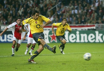 AMSTERDAM, NETHERLANDS -  SEPTEMBER 27:  Robert Pires of Arsenal scores from the penalty spot during the UEFA Champions League Group B match between Ajax and Arsenal at the Amsterdam Arena on September 27, 2005  in Amsterdam, Netherlands (Photo by Mike He