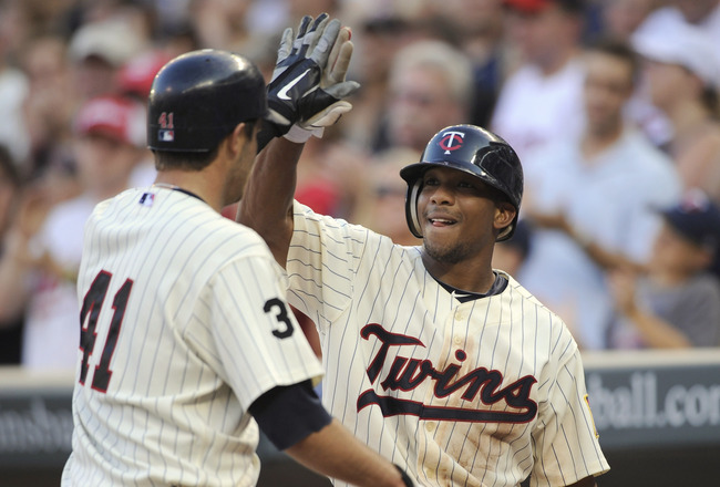 MINNEAPOLIS, MN - JULY 16: Ben Revere #11 of the Minnesota Twins celebrates a solo home run by Drew Butera #41 of the Minnesota Twins against the Kansas City Royals in the fourth inning on July 16, 2011 at Target Field in Minneapolis, Minnesota. (Photo by