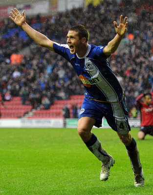 WIGAN, ENGLAND - FEBRUARY 05:  James McCarthy of Wigan Athletic celebrates after scoring to make it 1-1 during the Barclays Premier League match between Wigan Athletic and Blackburn Rovers at DW Stadium on February 5, 2011 in Wigan, England.  (Photo by Ch