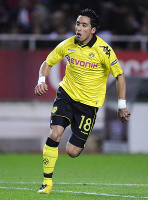 SEVILLE, SPAIN - DECEMBER 15:  Lucas Barrios of Borussia Dortmund runs during the UEFA Europa League group J match between Sevilla and Borussia Dortmund at Estadio Ramon Sanchez Pizjuan on December 15, 2010 in Seville, Spain. The match ended 2-2.  (Photo
