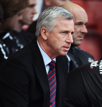 STOKE ON TRENT, ENGLAND - MARCH 19: Newcastle United Manager Alan Pardew looks on prior to the Barclays Premier League match between Stoke City and Newcastle United at Britannia Stadium on March 19, 2011 in Stoke on Trent, England.  (Photo by Bryn Lennon/