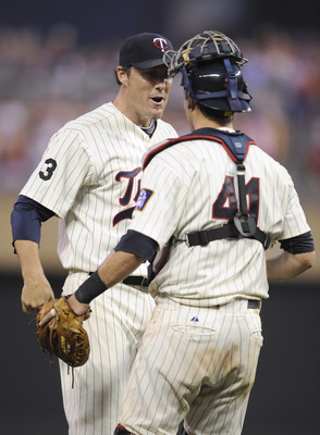 MINNEAPOLIS, MN - JULY 16: Joe Nathan #36 and Drew Butera #41of the Minnesota Twins celebrates a win against the Kansas City Royals on July 16, 2011 at Target Field in Minneapolis, Minnesota. The Twins defeated the Royals 4-3. (Photo by Hannah Foslien/Get